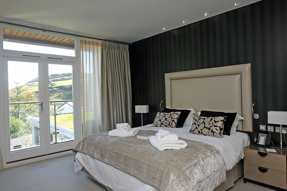 LawnrocRm1a 3/10/2016 The Llawnroc Hotel. Room 1, a double room with a balcony that has sea glimpses over a natural seeded roof that looks out to the hilltops that lead to the SouthWest Coastal Path.