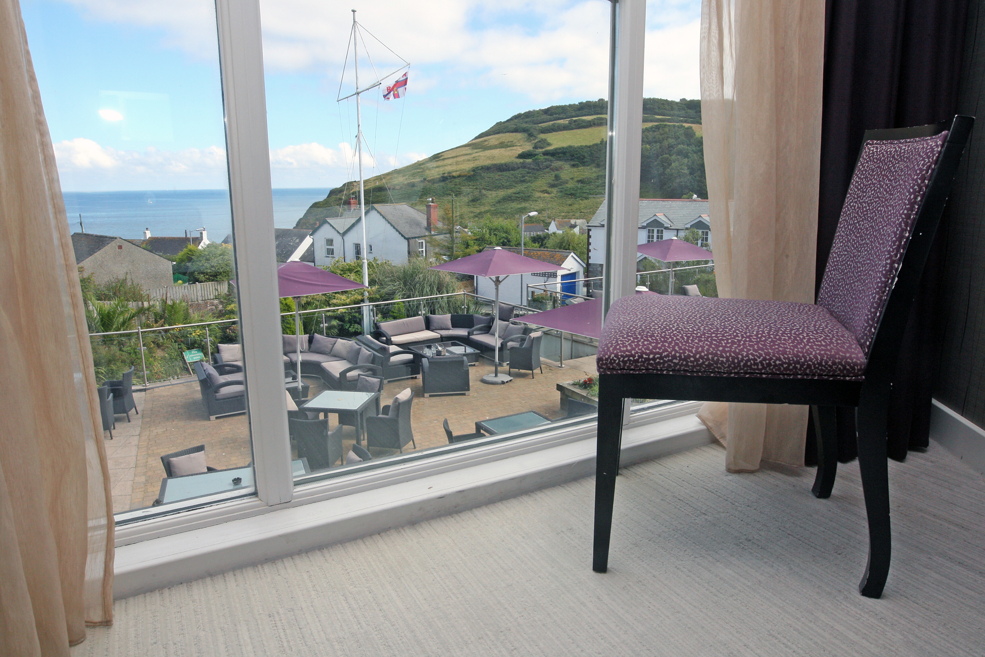 LawnrocRm6c 30/08/2016 The Llawnroc Hotel. Room 6, a double room with sea views over the hotel terrace, to the hilltops that lead to the SouthWest Coastal Path.