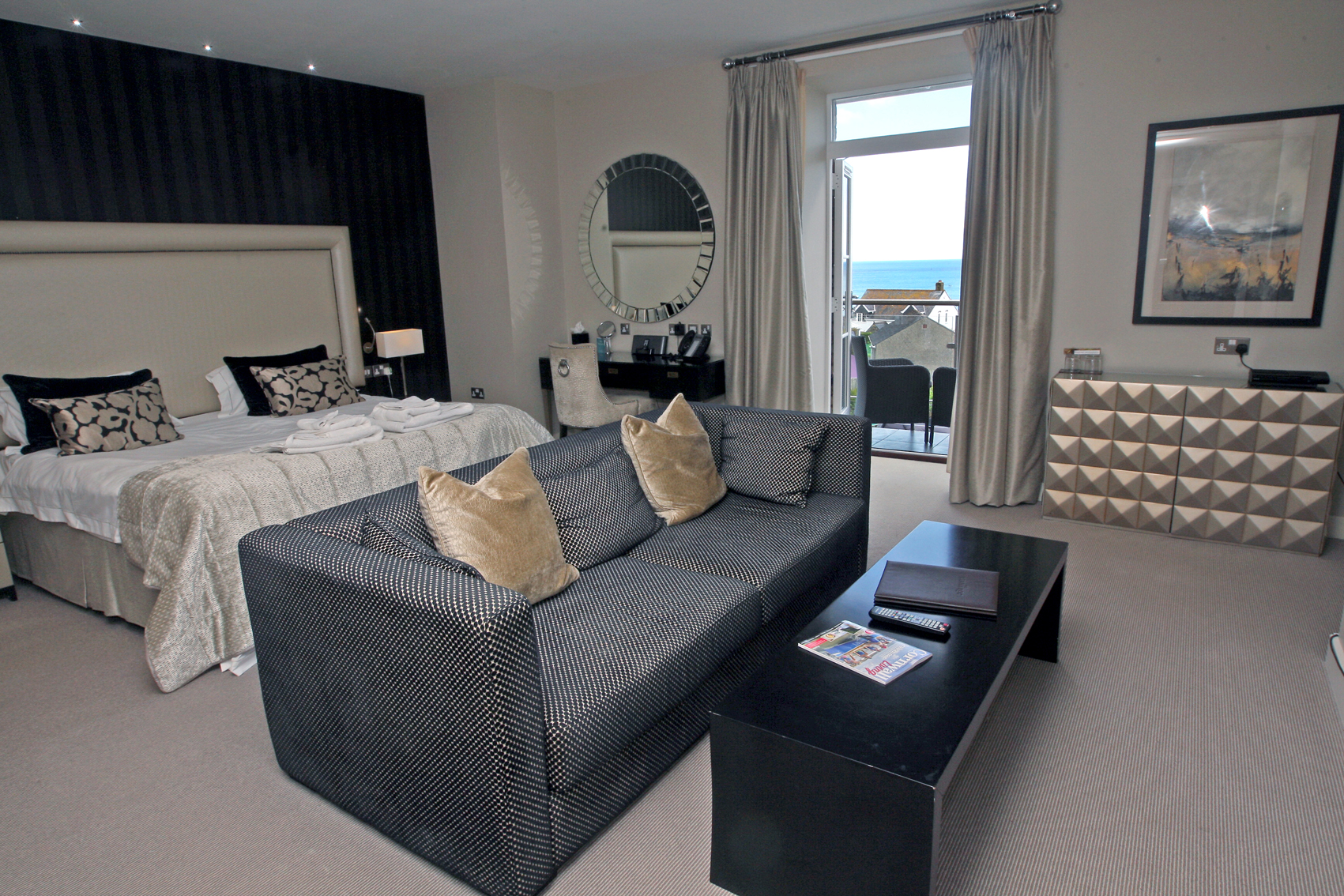 LlawnrocRm8c 16/06/2016 Room 8, a generous suite room with a balcony boasting sea views.