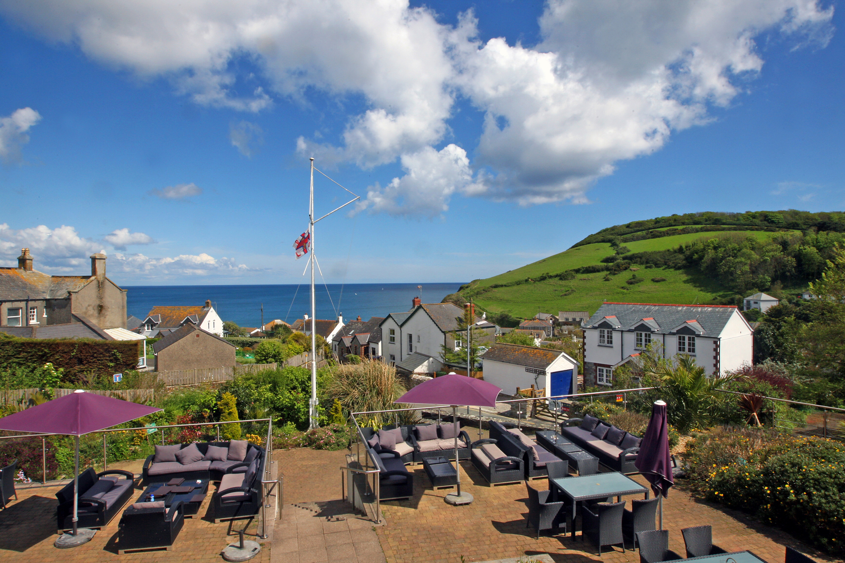 LlawnrocRm8f 16/06/2016 Room 8, a generous suite room with a balcony boasting sea views.