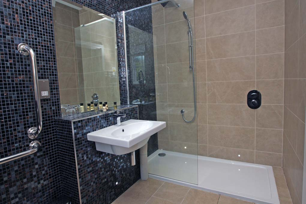 LawnrocRm12d 2/11/2016 The Llawnroc Hotel. Room 12, a large easy access double or twin standard room that overlooks the carpark and trees beyond. This room has a bathroom with a large walk in shower for ease of use.